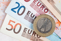Euro notes and coins. Group of euro notes and coins on a white background Royalty Free Stock Photography