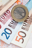 Euro notes and coins. Group of euro notes and coins on a white background Stock Photo