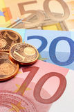 Euro notes and coins. Closeup. Shallow depth of field, focus on one cent coin. Used coins Royalty Free Stock Photography