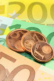 Euro notes and coins. Closeup. Shallow depth of field, focus on coins. Used coins royalty free stock image