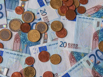 Euro notes and coins Stock Images