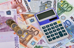 Euro Notes, Coins and Calculator. Calculator on the various euro banknotes and some coins royalty free stock images