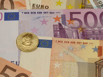 Euro notes and coins Stock Photos