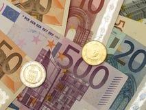 Euro notes and coins Stock Photos