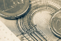 Euro notes and coins macro shot vintage style. Royalty Free Stock Images