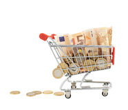 Euro notes and coins in a shopping cart Stock Image