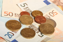 Euro notes and euro coins Stock Photography