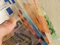 Euro notes, European Union. Hand holding Euro banknotes money (EUR), currency of European Union Royalty Free Stock Photography