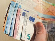 Euro notes, European Union. Hand holding Euro banknotes money (EUR), currency of European Union Stock Images