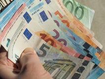 Euro notes, European Union. Hand holding Euro banknotes money (EUR), currency of European Union Stock Image