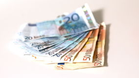 Euro notes falling on white surface Royalty Free Stock Images