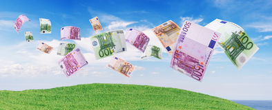 Euro notes flying away. Blue sky as background Stock Photo