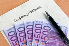 Euro notes and a foundation certificate Stock Images