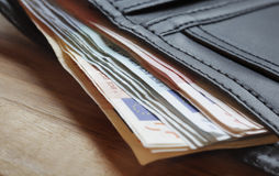 Euro notes protruding from wallet Royalty Free Stock Image
