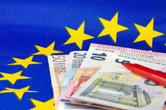 Euro notes and red pencil, EU flag Royalty Free Stock Image