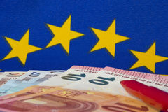 Euro notes and red pencil, EU flag Royalty Free Stock Images