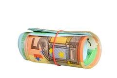 Euro notes roulées avec une boucle en caoutchouc image libre de droits