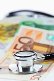 Euro notes and stethoscope Stock Photos