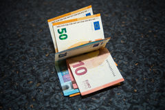 Euro notes sur une table Photographie stock