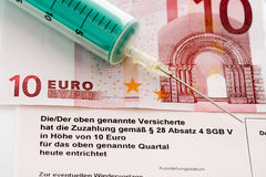 Euro notes and syringe, close up Stock Photo