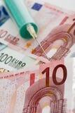 Euro notes and syringe, close up Royalty Free Stock Image