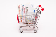 Euro notes in a trolley. On a white background Stock Photo