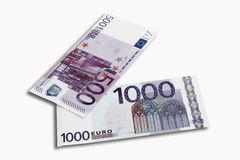 500 and 1000 Euro notes on white background, close-up Royalty Free Stock Images