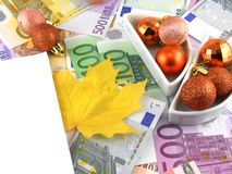 Euro Notes With Christmas Balls And Autumn Leave On It Stock Photos