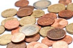 Euro- och centmyntcloseup Arkivfoton