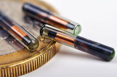 Euro och implantat Arkivbild