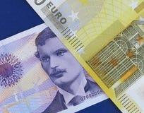 Euro och norsk krone royaltyfria foton