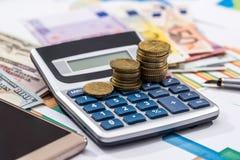 Euro och räknemaskin för woth för dollarräkningar Royaltyfri Foto