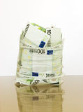 Euro in a opened cellophane package Stock Photos