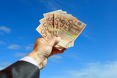 Euro over blue sky Stock Photography