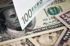 Euro over heap of dollars Royalty Free Stock Image