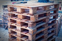 Euro pallets stacked to illustrate a construction site. In blue optic Royalty Free Stock Photos