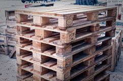 Euro pallets stacked to illustrate a construction site. In blue optic Stock Images