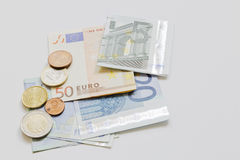Euro Paper Money and Coins Royalty Free Stock Photography