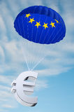 Euro parachute. Parachute with the european flag on it holding a Euro currency symbol - concept for security funds for debt ridden countries in Europe Royalty Free Stock Photography