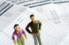 Euro Payroll and woman and man figurine Royalty Free Stock Photo
