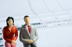 Euro Payroll and woman and man figurine Royalty Free Stock Image