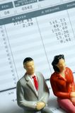 Euro Payroll and woman and man figurine Stock Images