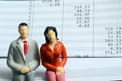 Euro Payroll and woman and man figurine Royalty Free Stock Photography