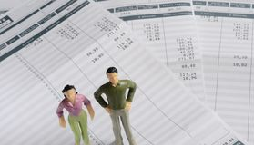 Euro Payroll and woman and man figurine Stock Image