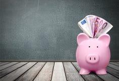 Euro pengar, piggybank Arkivbilder