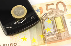 Euro pièce de monnaie et billet de banque d'argent Photographie stock
