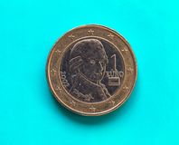 1 euro pièce de monnaie, Union européenne, Autriche au-dessus de vert-bleu Photos libres de droits
