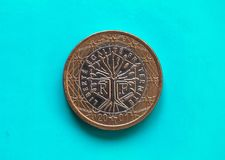 1 euro pièce de monnaie, Union européenne, France au-dessus de vert-bleu Photographie stock libre de droits