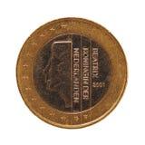 1 euro pièce de monnaie, Union européenne, Pays-Bas au-dessus du bleu d'isolement au-dessus du blanc Image libre de droits