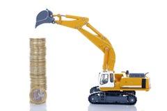 Euro pièces de monnaie d'argent avec le bêcheur Images stock